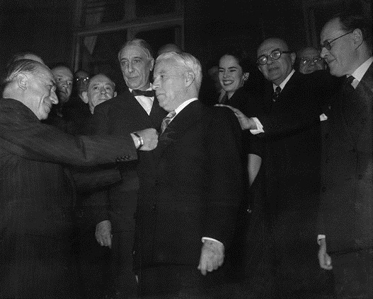 04 Nov 1952, Paris, France --- Original caption: Gets Medal. Paris, France: Actor Charlie Chaplin receives the Legion of Honor Medal during a meeting of the National Authors' Society. Andre Marie, French minister of education, makes the presentation. Chaplin's wife, Oona, looks on at left. --- Image by © Bettmann/CORBIS